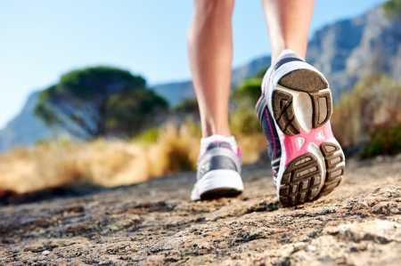 running shoes: athlete running sport feet on trail healthy lifestyle fitness
