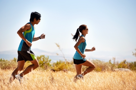 jogging shoes: couple running together training for marathon and fitness Stock Photo