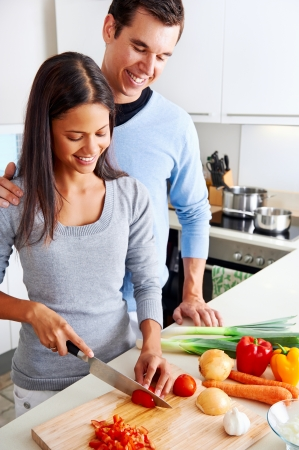 meal preparation: couple cooking healthy food in kitchen lifestyle meal preparation Stock Photo
