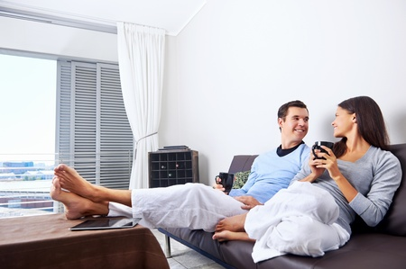 Couple relax at home with cup of coffee and sofa couch. happy healthy relationship Stock Photo - 19385148