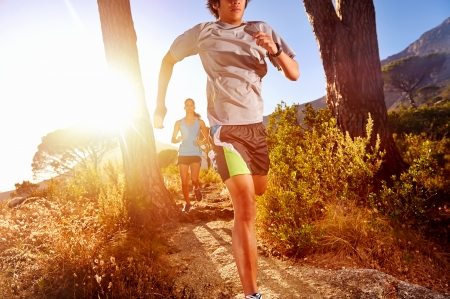 man exercise: Trail running marathon athlete outdoors sunrise couple training for fitness and healthy lifestyle