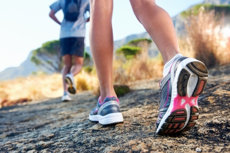 running shoes: trail running marathon fitness feet on rock fitness and healthy lifestyle