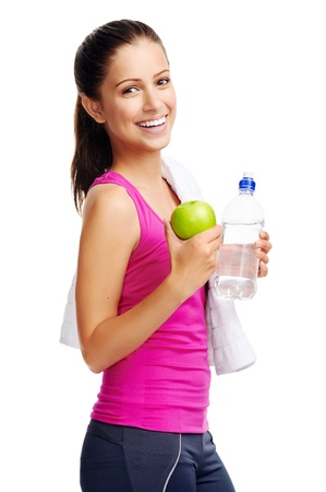 woman in towel: Healthy woman with water and apple diet smiling isolated on white
