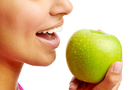 woman eating apple healthy diet and strong teeth photo