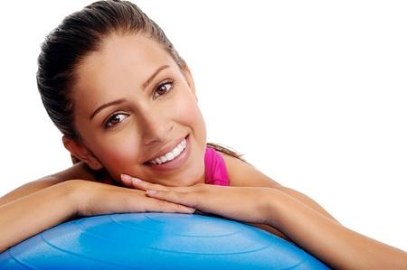 beautiful portrait of gym woman and swiss ball photo