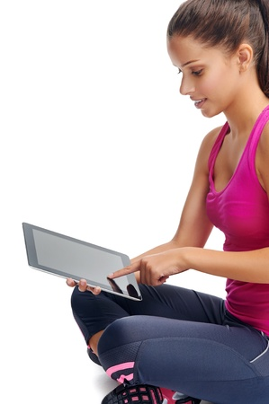 computer clubs: healthy gym girl searches for new lifestyle fitness apps on her computer tablet