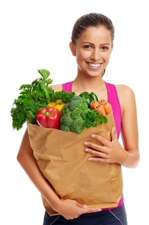 Portrait of woman with groceries shopping bag full of healthy vegetables smiling photo