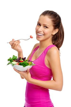 ni�a comiendo: Mujer sana de comer con ensalada aislado en blanco Foto de archivo