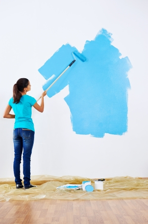 woman painting wall in new home Stock Photo - 20237234