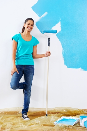 portrait of woman posing with paint roller in new apartment renovation Stock Photo - 20237592
