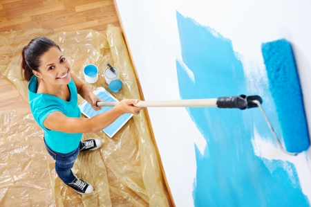 overhead view of woman painging new apartment standing on wooden floor Imagens - 20237674