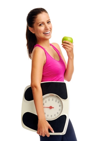 weightloss: healthy diet eating woman with scale and apple for weightloss