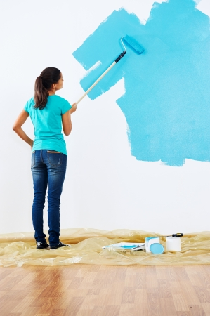 woman painting wall in new home Stock Photo - 20571338