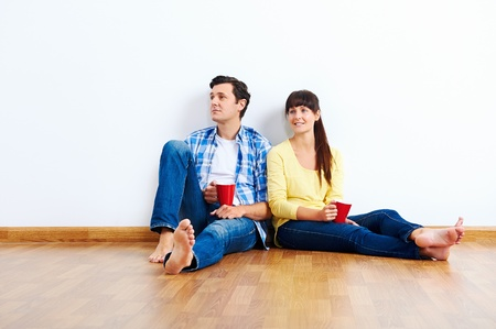 couple moving in to new home, empty floor Stock Photo - 20863398