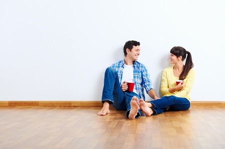 couple moving in to new home, empty floor Stock Photo - 20863399