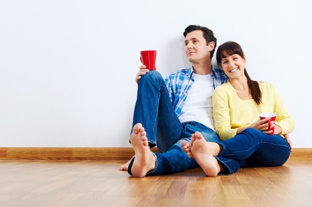 couple moving in to new home, empty floor Stock Photo - 20863407
