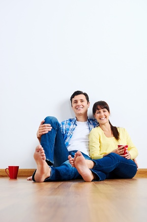 couple moving in to new home, empty floor Stock Photo - 20863408