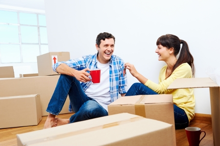couple celelbrating new home handing keys and moving boxes Stock Photo - 20863427