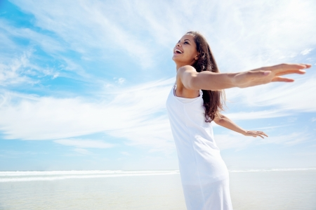 female portrait: Woman with amrs out carefree healthy summer lifestyle on holiday