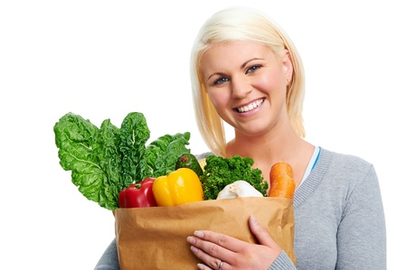 healthy eating diet woman with fresh vegetables in shopping bag photo