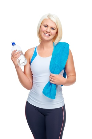 quench: workout fitness woman with water bottle to quench thirst