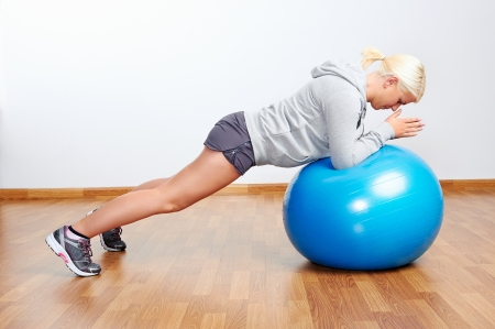 pilates ball fitness workout woman in gym photo