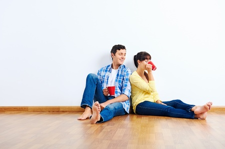 couple moving in to new home, empty floor Stock Photo - 20943942