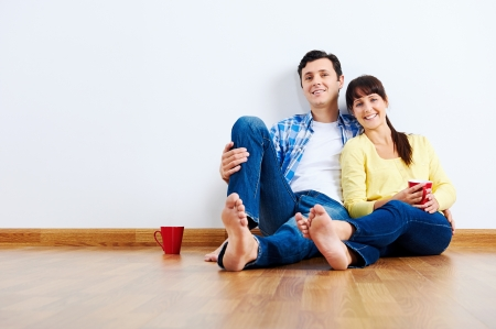 couple moving in to new home, empty floor Stock Photo - 20943943