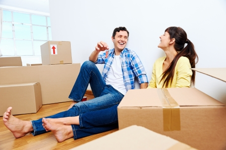 couple celelbrating new home handing keys and moving boxes Stock Photo - 20943964