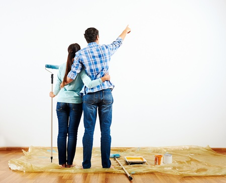 renovation diy paint couple in new home painting wall photo