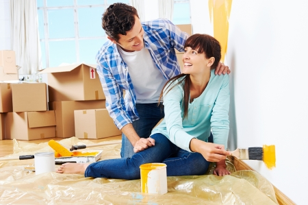 renovation diy paint couple in new home painting wall Stock Photo - 20904666