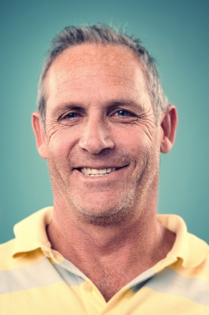 Smiling portrait face of real man with retro colour and high detail photo