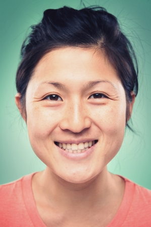Smiling portrait face of real woman with retro colour and high detail
