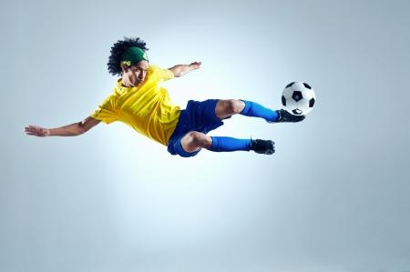 soccer football kick striker scoring goal with accurate shot for brazil team  Zdjęcie Seryjne