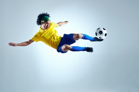 football boots: soccer football kick striker scoring goal with accurate shot for brazil team  Stock Photo