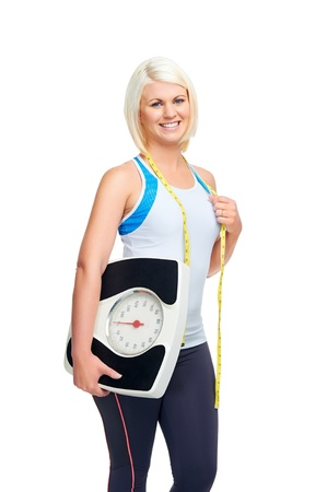 weightloss woman with scale showing diet and exercise concept photo