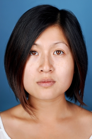 Portrait of real chinese woman on blue background Stock Photo - 22256376