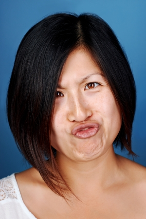 real funny face of chinese asian woman portrait Stock Photo - 22256378