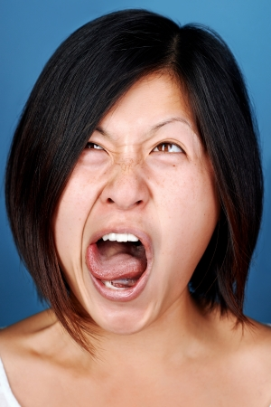 real funny face of chinese asian woman portrait Stock Photo - 22256379