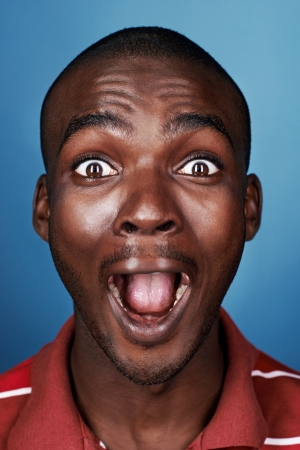 portrait of funny face real african man screaming face Stock Photo