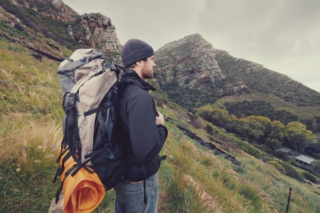 Adventure man hiking wilderness mountain with backpack, outdoor lifestyle survival vacation Stock Photo - 23032050
