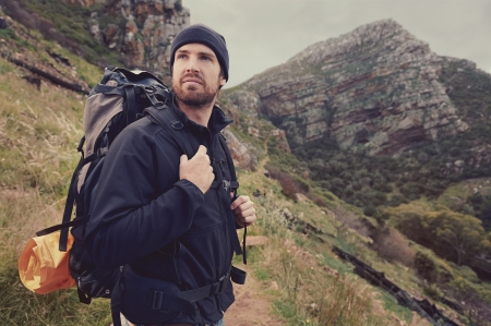 exlore: Potrait of adventure trekking man in mountains with backpack