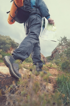 exlore: Hiker with map and backpack in outdoors lifestyle Stock Photo