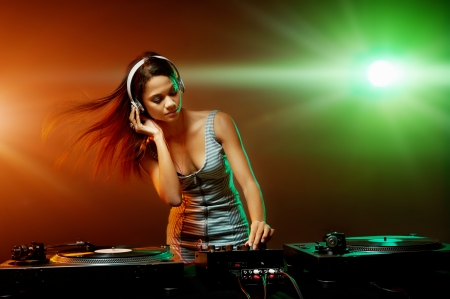 dj music: real woman dj playing music at party Stock Photo