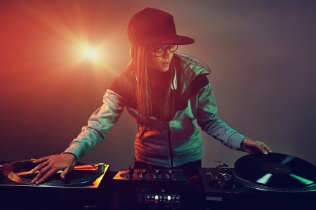 dj party: Hiphop dj woman playing at nightclub party lifestyle