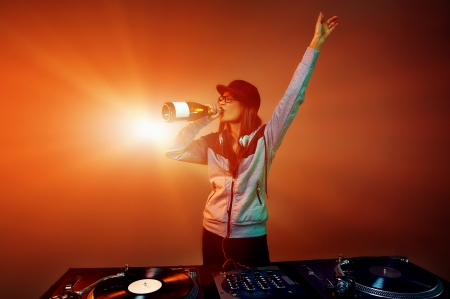 nightclub dj party with bubbly champagne and vinyl music playing Stock Photo - 22885682