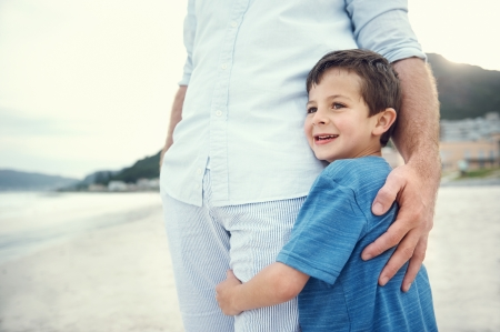 parents  love: Feeling of safety and security, love hug from father and son at beach