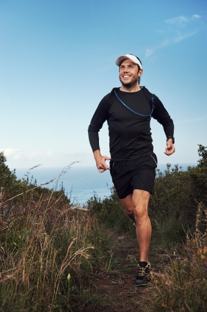 happy running man on trail exercising outdoors photo