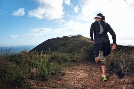 mountain man: trail running man on mountain path exercising Stock Photo
