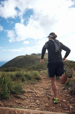 caucasian race: trail running man on mountain path exercising Stock Photo